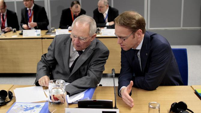 Germany's Finance Minister Wolfgang Schauble, left, and Germany's Central Bank Governor Dr. Jens Weidmann talk during the Informal Meeting of ECOFIN Ministers in Dublin Castle, Ireland, Saturday, April 13, 2013. (AP Photo/Peter Morrison)