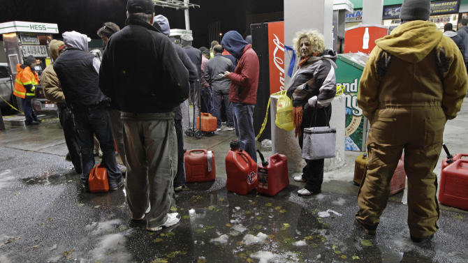 People wait in line for gasoline at a Hess station in Brooklyn, where gas is still scarce, Thursday, Nov. 8, 2012, in New York.  Fuel shortages and distribution delays that led to gas hoarding have prompted New York City and Long Island to initiate an even-odd gas rationing plan which begins Friday at 6 a.m. in New York and 5 a.m. in Long Island. (AP Photo/Kathy Willens)