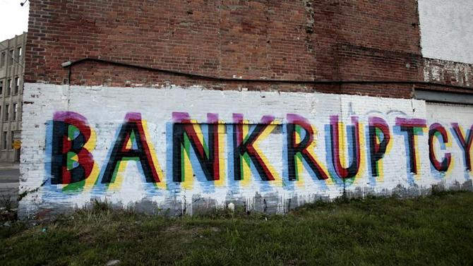 The word 'Bankruptcy' is seen painted on the side of a vacant building by street artists as a statement on the financial affairs of the city on Grand River Avenue in Detroit