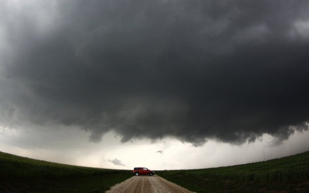A storm chaser gets close to a tornadic thunderstorm, one of several tornadoes that touched down in Kansas
