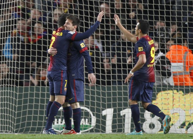 Barcelona's Villa celebrates his goal with teammate Messi and Alexis against Rayo Vallecano during their Spanish first division match in Barcelona