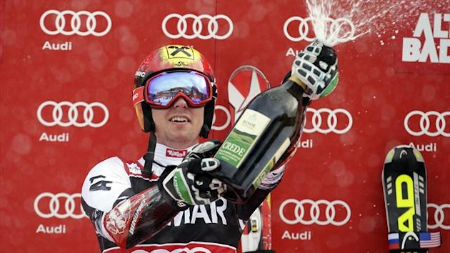 Marcel Hirscher of Austria celebrates on the podium after winning in the men's World Cup Giant Slalom skiing race in Alta Badia December 22, 2013 (Reuters)