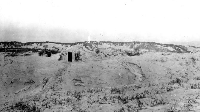 This July 14, 1912 photo courtesy of the U.S. Geological Survey shows barabaras (sod houses) in Douglas (now Kaguyak) village, covered with ash from the 1912 eruption of Novarupta in Alaska. A century after one of the world's largest volcanic eruptions, ash and pumice are still plentiful in Alaska's Valley of Ten Thousand Smokes. The three-day explosion that began June 6, 1912, spewed ash 100,000 feet above the state's Katmai region, covering the valley to depths up to 700 feet. (AP Photo/U.S. Geological Survey, G.C. Martin)