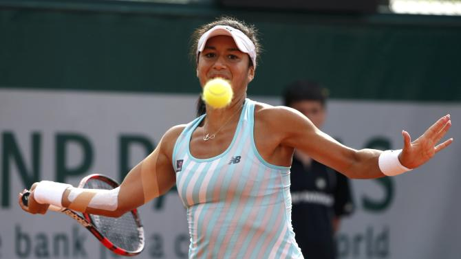 Heather Watson of Britain eyes the ball as she plays a shot to Sloane Stephens of the U.S. during their women's singles match at the French Open tennis tournament at the Roland Garros stadium in Paris