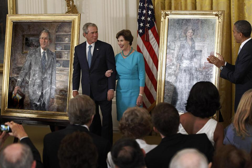 President Barack Obama applauds as former President George W. Bush and former first lady Laura Bush stand during the unveiling of their official portraits, Thursday, May 31, 2012, in the East Room at the White House in Washington. (AP Photo/Charles Dharapak)