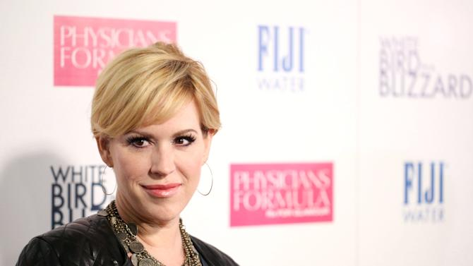 "Molly Ringwald arrives at the premiere of ""White Bird in a Blizzard"" presented by FIJI Water on Tuesday, Oct. 21, 2014 in Los Angeles. (Photo by Matt Sayles/Invision for FIJI Water/AP Images)"