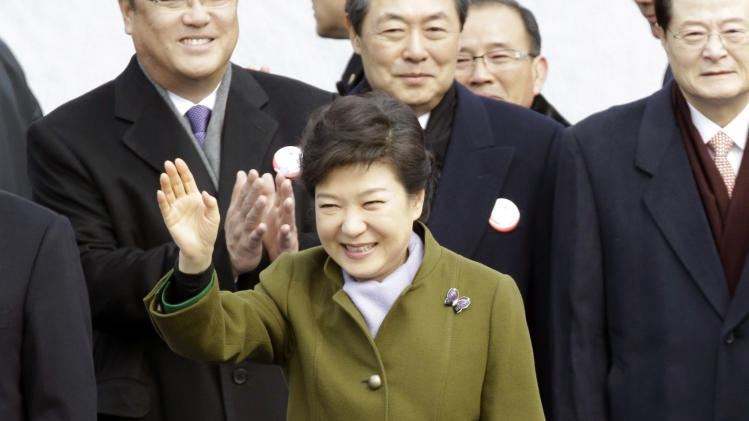 South Korean President Park Geun-hye waves upon arriving to her inauguration ceremony at the National Assembly in Seoul, South Korea, Monday, Feb. 25, 2013. Park became South Korea's first female president Monday, returning to the presidential mansion where she grew up with her dictator father.   (AP Photo/Lee Jin-man)