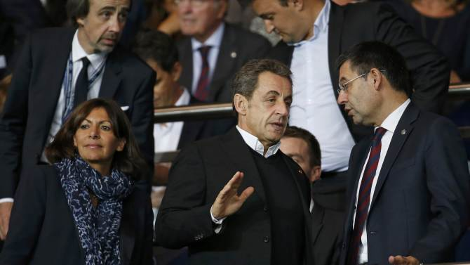 Paris Mayor Hidalgo and France's former president Sarkozy arrive to attend the Champions League Group F soccer match opposing Paris St Germain and Barcelona at the Parc des Princes Stadium in Paris