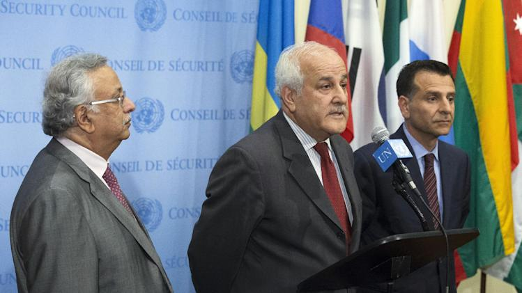 "Palestinian U.N. Ambassador Riyad Mansour, center, speaks following a meeting of the U.N. Security Council on the situation in Gaza at United Nations headquarters, Monday, July 28, 2014. The U.N. Security Council called for ""an immediate and unconditional humanitarian cease-fire"" in the Gaza war between Israel and Hamas at an emergency meeting just after midnight Monday morning. (AP Photo/John Minchillo)"