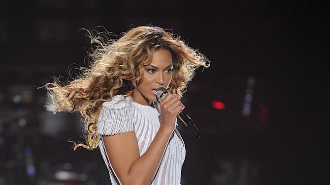 """Singer Beyonce performs on the opening night of her """"Mrs. Carter Show World Tour 2013"""", on Monday, April 15, 2013 at the Kombank Arena in Belgrade, Serbia. Beyonce is wearing a custom, hand beaded white peplum one-piece by designers Ralph & Russo. (Photo by Frank Micelotta/Invision for Parkwood Entertainment/AP Images)Singer Beyonce performs on the opening night of her """"Mrs. Carter Show World Tour 2013"""", on Monday, April 15, 2013 at the Kombank Arena in Belgrade, Serbia. Beyonce is wearing a custom, hand beaded white peplum one-piece by designers Ralph & Russo.(Photo by Frank Micelotta/Invision for Parkwood Entertainment/AP Images)"""