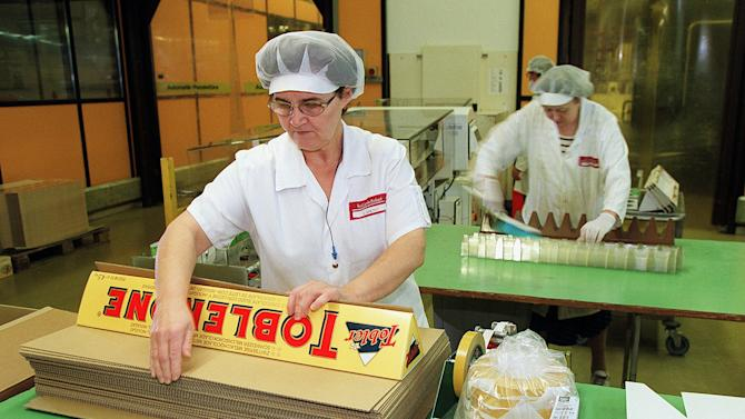 """FILE - In this Nov. 26, 1999 file photo, employees package large Toblerone chocolate bars at the Kraft Jacobs Suchard AG factory in Bern, Switzerland. A study published in the New England Journal of Medicine on Wednesday, Oct. 10, 2012 ties chocolate consumption to the number of Nobel Prize winners a country has and suggests it's a sign that the sweet treat can boost brain power. It was published online as a """"note"""" rather than a rigorous, peer-reviewed study. (AP Photo/Keystone, Martin Ruetschi)"""