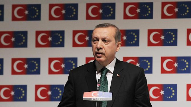 """Turkish Prime Minister Recep Tayyip Erdogan delivers a speech during a conference in Istanbul on Friday, June 7, 2013. A senior European Union official on Friday criticized Turkish police's harsh crackdown on protesters told an audience including Erdogan that a """"swift and transparent"""" investigation was needed. (AP Photo/Thanassis Stavrakis)"""