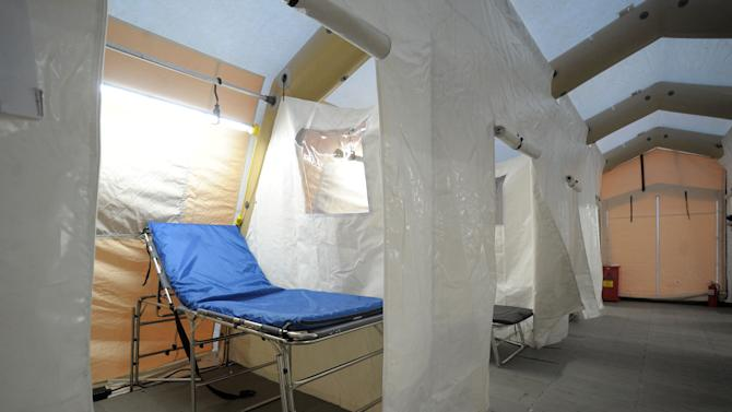 This Monday, Jan. 7, 2013 photo shows a tent prepared for expected flu patients outside of the Emergency Room at Lehigh Valley Hospital at Cedar Crest, in Salisbury Township, Pa. The tent was set up after cases were piling up at the Salisbury Township hospital Monday, with the hospital reporting an extremely busy flu season so far. The flu season arrived early in the U.S. this year, but health officials and experts say it's too early to say this will be a bad one. Experts say evidence so far is pointing to a moderate flu season - it just looks worse because last year's season was so mild. Flu usually doesn't blanket the country until late January or February. Now, it's already widespread in more than 40 states. That could change when the next government report comes out Friday. (AP Photo/Express-Times, www.lehighvalleylive.com, Matt Smith)