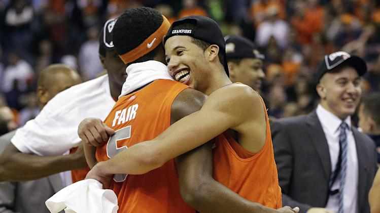 Syracuse guard Michael Carter-Williams (1) hugs forward C.J. Fair (5) after their 55-39 win over Marquette in the East Regional final of the NCAA men's college basketball tournament, Saturday, March 30, 2013, in Washington. (AP Photo/Pablo Martinez Monsivais)