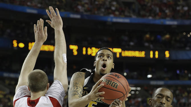 Wichita State's Demetric Williams (5) heads to the hoop as Louisville's Stephan Van Treese, left and Louisville's Russ Smith defend during the first half of the NCAA Final Four tournament college basketball semifinal game Saturday, April 6, 2013, in Atlanta. (AP Photo/David J. Phillip)