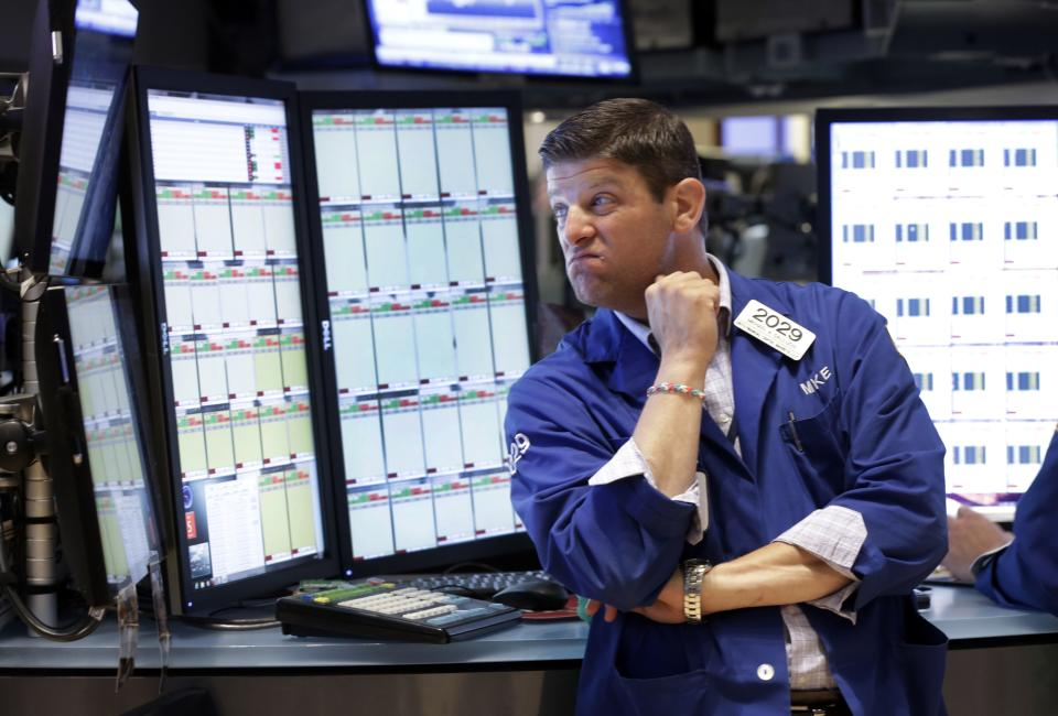 Trader Michael Gallucci works on the floor of the New York Stock Exchange Friday, July 5, 2013. Robust hiring in the U.S. is boosting the stock market in early trading. (AP Photo/Richard Drew)