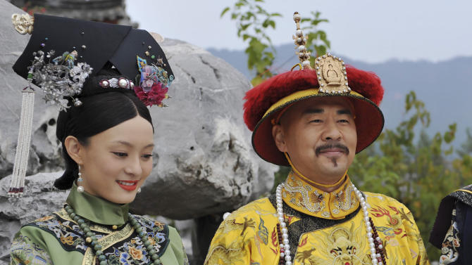 "This undated photo released by Videoland Cable Network Taiwan shows Chinese actress Sun Li and actor Chen Jian Bin in costumes on set of the TV series ""The Legend of Zhen Huan"" in mainland China. Set in the imperial palace of the Qing dynasty in the 17th century ""The Legend of Zhen Huan"" is a TV drama series written by a 28-year-old Chinese online fiction writer that has captivated viewers in Taiwan, but its emphasis on the dark side of human nature has made it less popular with cultural authorities in China. (AP Photo/Videoland Cable Network) EDITORIAL USE ONLY"