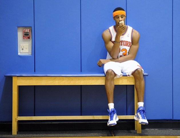New York Knicks' Toure' Murry checks Twitter on his cell phone. (AP/Bill Kostroun)