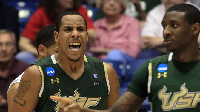 South Florida forward Ron Anderson Jr. (1) yells at Jawanza Poland (5) after Poland scored late in the second half of their 65-54 win over California in an NCAA tournament first-round college basketball game, Wednesday, March 14, 2012, in Dayton, Ohio. (AP Photo/Al Behrman)