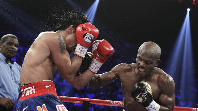 Timothy Bradley, from Palm Springs, Calif., goes on the offense against Manny Pacquiao, from the Philippines, in their WBO world welterweight title fight Saturday, June 9, 2012, in Las Vegas. Bradley won the fight by split decision. (AP Photo/Julie Jacobson)