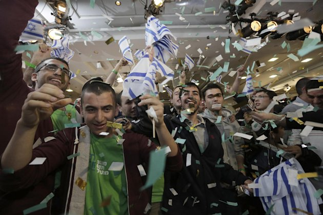 Supporters of Naftali Bennett, head of Israel's Jewish Home party celebrate after the exit polls were announced at the party's headquarters in the city of Ramat Gan, Tuesday, Jan. 22, 2013.  Israeli P