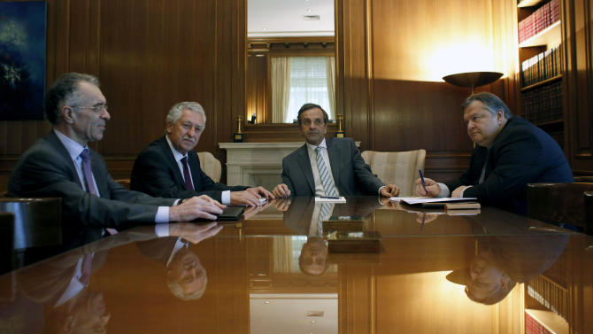 New Greek Prime Minister Antonis Samaras, center, during his meeting with the heads of his two minority coalition partners, Evangelos Venizelos from the Greek Socialist PASOK party, right, and the smaller Democratic Left's Fotis Kouvelis, 2nd left, and banker Vassilis Rapanos, left, in Athens, Thursday, June 21 2012.  Samaras is set to announce his cabinet Thursday, a day after brokering a three-party governing coalition that ends weeks of political uncertainty in the crisis-afflicted country.All three coalition parties have promised to broadly respect Greece's pledges to undertake further harsh austerity measures and reforms, conditions demanded by European partners and the International Monetary Fund in return for more bailout loans.(AP Photo/Kostas Tsironis)