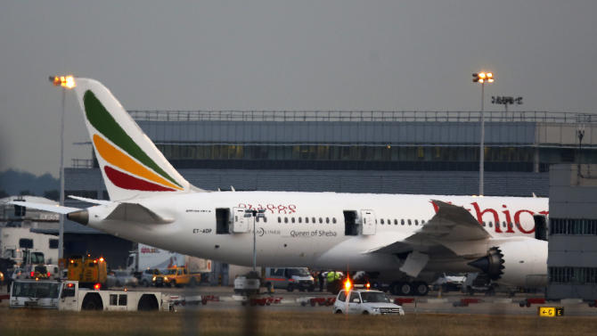 """In this July 12, 2013, photo, a general view of the Air Ethiopian Boeing 787 Dreamliner 'Queen of Sheba' plane on the runway near Terminal 3, at Heathrow Airport, London. U.S. aviation officials say they want the emergency locator transmitters on all Boeing 787 """"Dreamliners"""" inspected following a fire aboard the Queen of Sheba that was parked at London's Heathrow Airport. The Federal Aviation Administration said late Friday that after reviewing recommendations by British accident investigators, the agency is working with Boeing to develop instructions for airlines on how to conduct the inspections. (AP Photo/Sang Tan, File)"""