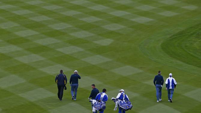 European Ryder Cup players walk up the fairway during practice ahead of the 2014 Ryder Cup at Gleneagles