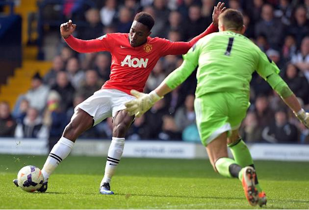 Danny Welbeck (left) strikes the ball past Ben Foster to score for Manchester United at The Hawthorns on March 8, 2014