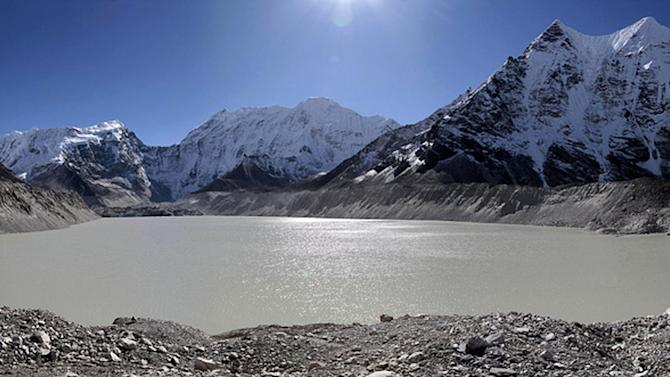 In this photo taken in October 2009 and released by WWF, Imza Lake lies near the foothills of Mount Everest, near legendary mountaineer Apa Sherpa's old home in Nepal. Apa used to circle along a track skirting the water's edge but the trails have long since disappeared underwater. Apa, who has scaled the world's highest mountain a record 21 times, is on a quest to draw attention to the danger of more devastating floods as glacial melt caused by climate change fills mountain lakes to the bursting point. (AP Photo/WWF, Steve Morgon) EDITORIAL USE ONLY