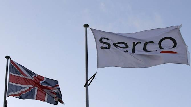 File photograph shows a Serco flag flying alongside a Union flag outside Doncaster Prison in northern England