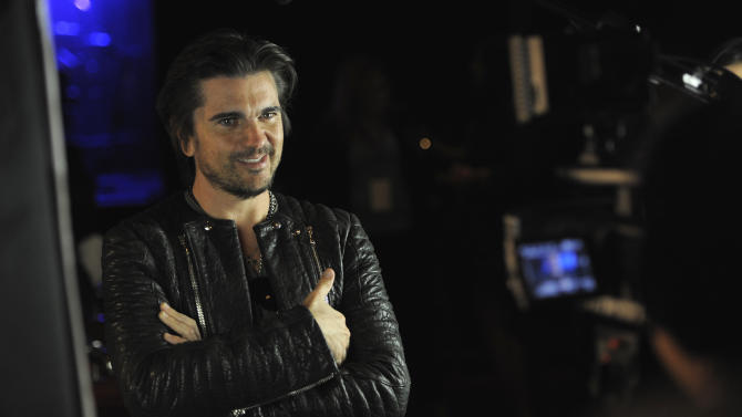 Grammy award winner Juanes answers questions for the After-School All-Stars at a private concert presented by tour sponsors MetroPCS & ZTE, on Monday, February, 11, 2013 at the El Rey Theatre in Los Angeles. (Photo by Chris Pizzello/Invision for MetroPCS/AP Images)