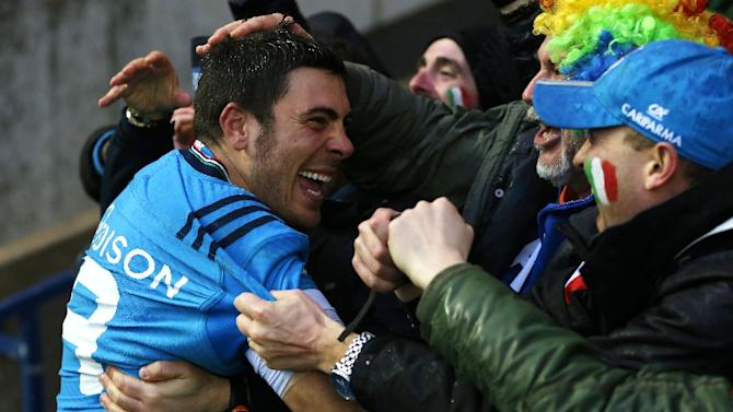 Italy scrum half Edoardo Gori celebrates with fans at full time in the Six Nations international against Scotland at Murrayfield in Edinburgh on February 28, 2015. Italy won the game 22-19