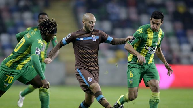 Tondela's Dolly and Souza in action with Porto' Andre