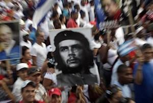 People carry an image of revolution leader Che Guevara during the May Day parade in Havana's Revolution Square