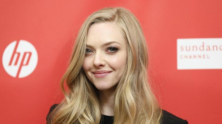 """Cast member Amanda Seyfried poses at the premiere of """"Lovelace"""" during the 2013 Sundance Film Festival on Tuesday, Jan. 22, 2013 in Park City, Utah. (Photo by Danny Moloshok/Invision/AP)"""