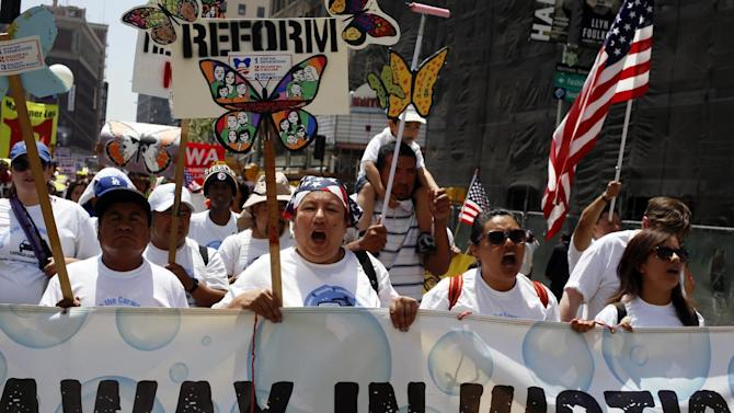 Car wash workers with the Community Labor Environmental Action Network (CLEAN) Carwash Campaign march during a May Day rally in downtown Los Angeles on Wednesday, May 1, 2013. In celebration of May Day, people have gathered across the country to rally for various topics including immigration reform. (AP Photo/Damian Dovarganes)