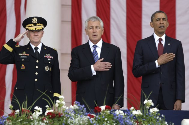 Obama stands for the national anthem with Dempsey and Hagel as he takes the stage for remarks at the Memorial Day observances at Arlington National Cemetery in Arlington