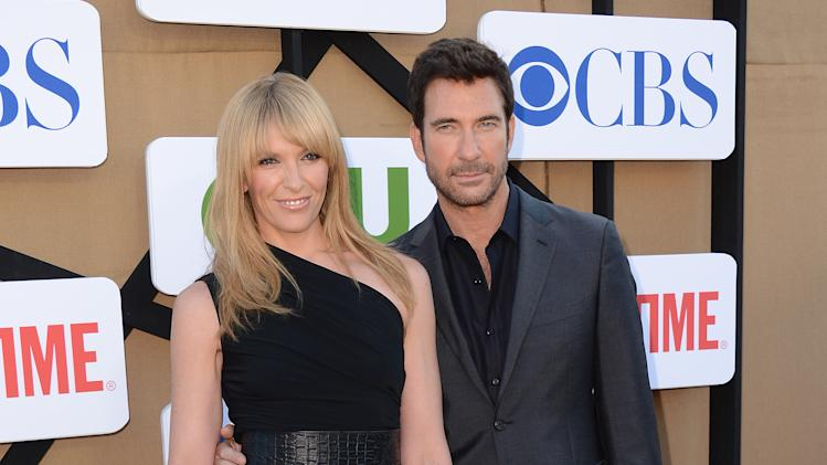 From left, Toni Collette and Dylan McDermott arrive at the CBS, CW and Showtime TCA party at The Beverly Hilton on Monday, July 29, 2013 in Beverly Hills, Calif. (Photo by Jordan Strauss/Invision/AP)