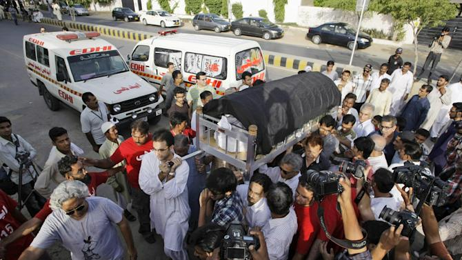 Pakistani relatives and mourners of Zohra Shahid, a senior member of former Pakistani cricket star Imran Khan's Pakistan Tehreek-e-Insaf party in Sindh, carry her body during her funeral procession in Karachi, Pakistan, Sunday, May 19, 2013. Police said gunmen on a motorcycle shot and killed Shahid outside her home on Saturday, May 18, 2013, in the city of Karachi in the southern Sindh province. (AP Photo/Fareed Khan)