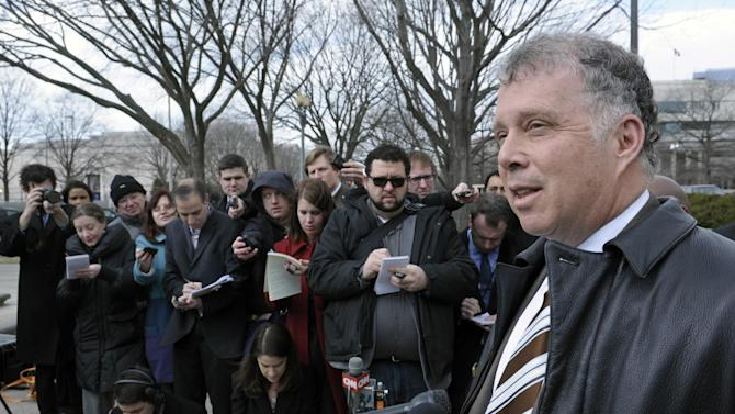 Attorney Reid Weingarten, representing former Illinois Rep. Jessie Jackson, Jr., speaks to reporters outside federal court in Washington, Wednesday, Feb. 20, 2013, after Jackson entered a guilty plea to criminal charges that he engaged in an alleged scheme to spend $750,000 in campaign funds on personal items. (AP Photo/Cliff Owen)