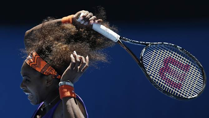 Serena Williams of the US hits a forehand return to compatriot Sloane Stephens during their quarterfinal match at the Australian Open tennis championship in Melbourne, Australia, Wednesday, Jan. 23, 2013.  (AP Photo/Andy Wong)