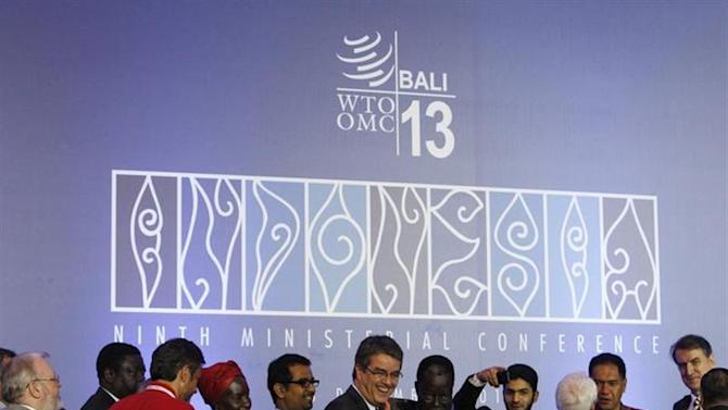 Director-General Roberto Azevedo gives a thumbs-up as he greets delegates after the closing ceremony of the ninth World Trade Organization (WTO) Ministerial Conference in Nusa Dua, on the Indonesian resort island of Bali December 7, 2013. REUTERS/Edgar Su