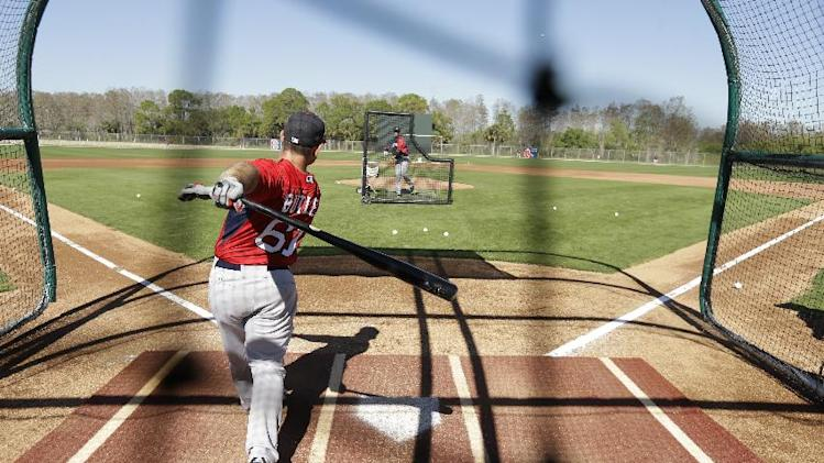 Boston Red Sox catcher Dan Butler takes batting practice during spring training baseball practice Tuesday, Feb. 18, 2014, in Fort Myers, Fla. (AP Photo/Steven Senne)