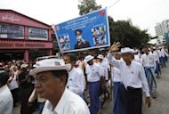 Myanmar people take part in a parade in honour of independence hero General Aung San. Myanmar honoured democracy champion Aung San Suu Kyi's father and eight other slain independence heroes at an official ceremony Thursday that underscored the political changes sweeping the country