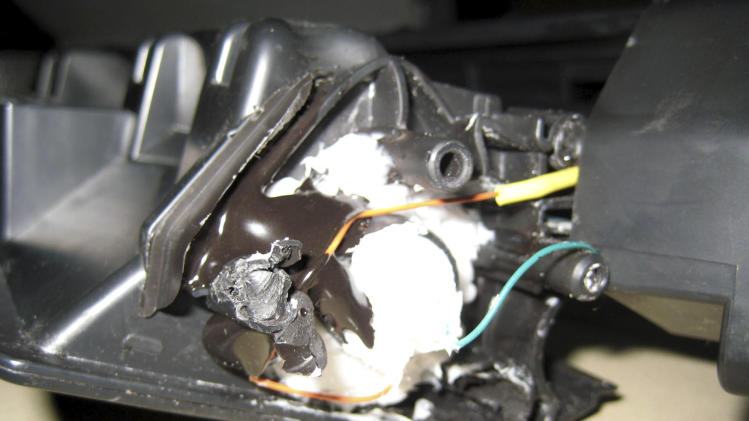 This undated photo released by the Dubai Police via the state Emirates News Agency (WAM) on Saturday, Oct. 30, 2010, claims to show parts of a computer printer with explosives loaded into its toner cartridge found in a package onboard a cargo plane coming from Yemen, in Dubai, United Arab Emirates. Dubai police say the bomb, discovered in the ink cartridge of a computer printer in a shipment of air cargo from Yemen bound for the United States, contained the powerful explosive PETN and bore the hallmarks of al-Qaida. (AP Photo/Dubai Police via Emirates News Agency) EDITORIAL USE ONLY, NO SALES