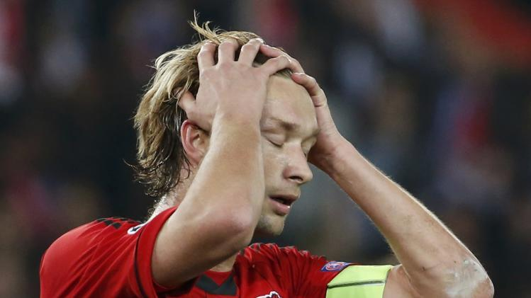 Bayer Leverkusen's Simon Rolfes reacts after missing a penalty against Paris St Germain during their Champions League round of 16 second leg soccer match at the Parc des Princes Stadium in Paris