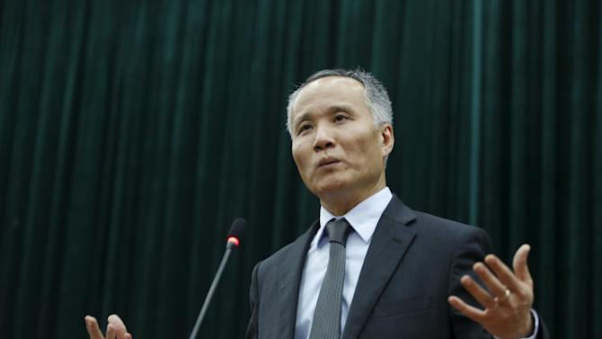 Vietnam's Vice Minister of Industry and Trade Khanh gestures during a news conference on TPP in Hanoi