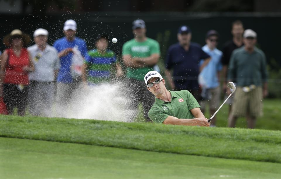 Adam Scott, of Australia, hits from a bunker on the fourth hole during a practice round for the PGA Championship golf tournament at Oak Hill Country Club, Tuesday, Aug. 6, 2013, in Pittsford, N.Y. (AP Photo/Patrick Semansky)
