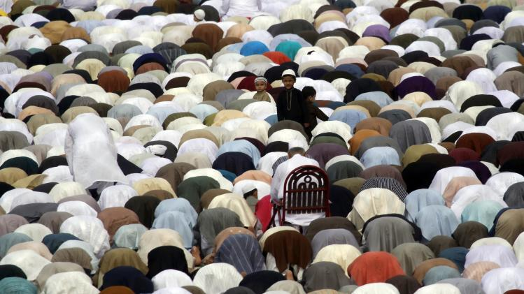 Muslims say their Eid al-Fitr prayers in Karachi